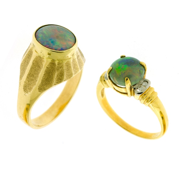 2 Var Yellow Gold Opal Rings. Incl. 18ct oval claw set, with 4 shoulder diamonds; & 14ct oval, bezel set.
