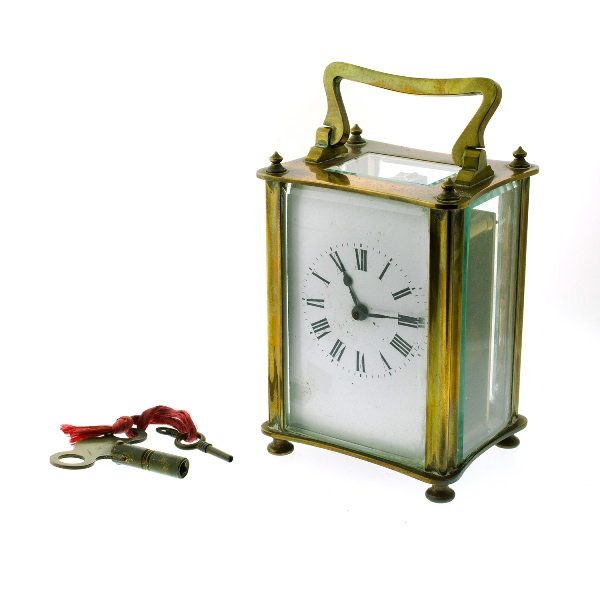 French Brass Carriage Clock. Platform lever escapement. Enamel dial. Roman figures. Operates but may need service. Keys available.