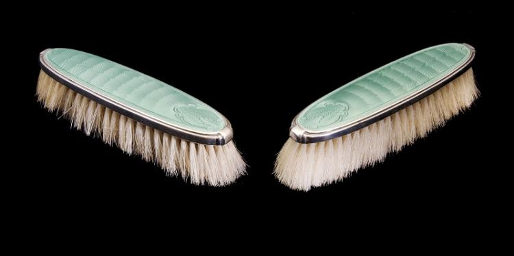 Pr Geo V HMSS Clothes Brushes. Birm. 1933, makers Adie Brothers. Green enamel backs.