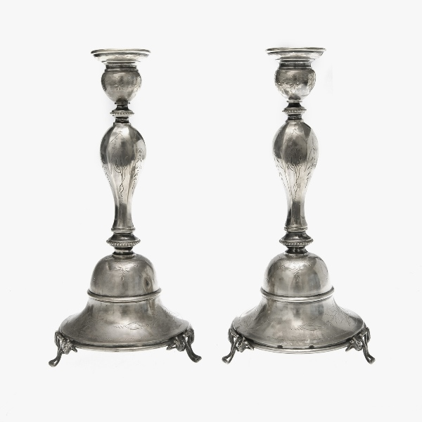 Pr Early Austro-Hungarian Silver Candlesticks.  Engraved decoration. Each tri-footed. Hallmarks stamped to bases. Small dents.