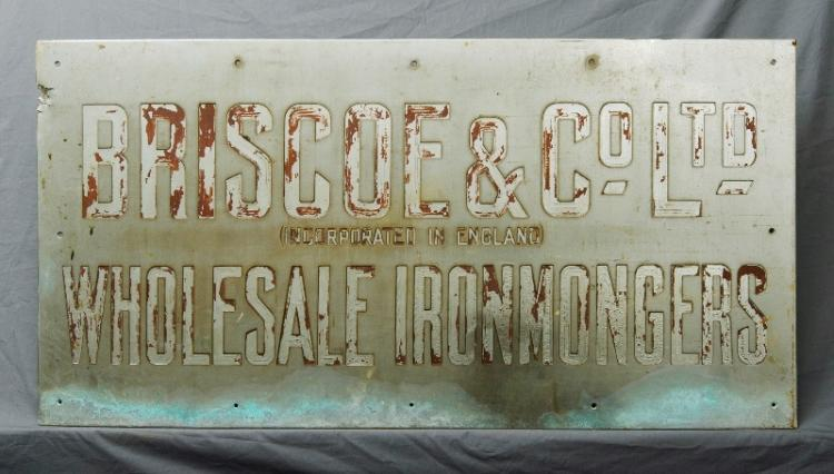 Early Briscoe & Co Ltd Advertising Sign. 'Wholesale Ironmongers'. Relief engraved. c1930s.