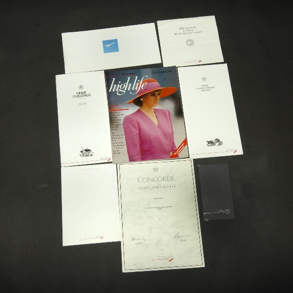 1990 Concorde Flight Souvenir Pack.  Incl. 'Hilife' magazine, menu, inflight entertainment guide, certificate, notebook & pencil etc.  In original Concorde plastic wallet/folder.