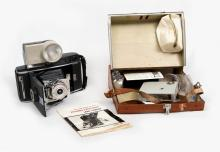 Cased Early Polaroid Land Camera.  Pathfinder model with instruction booklet, Wink light & battery pack.