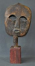 West African Carved Mask. On wooden stand. H55cm
