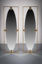 A PAIR OF BRASS FRAMED ELLIPTICAL WALL MIRRORS, 135cm (h) x 43cm (w).