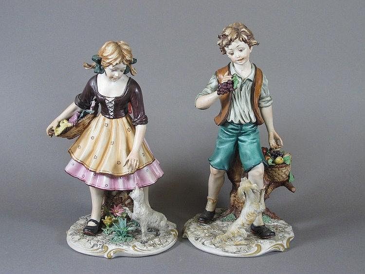 A pair of Capo di Monte biscuit porcelain figures