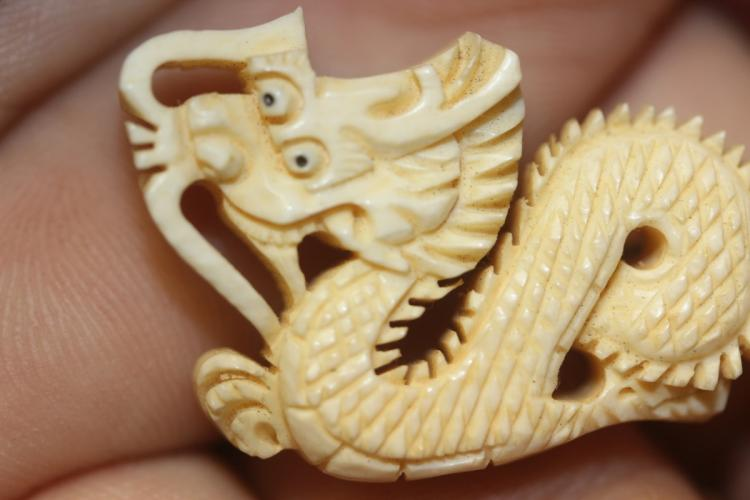 A Carved Bone Dragon Pin Or Brooch