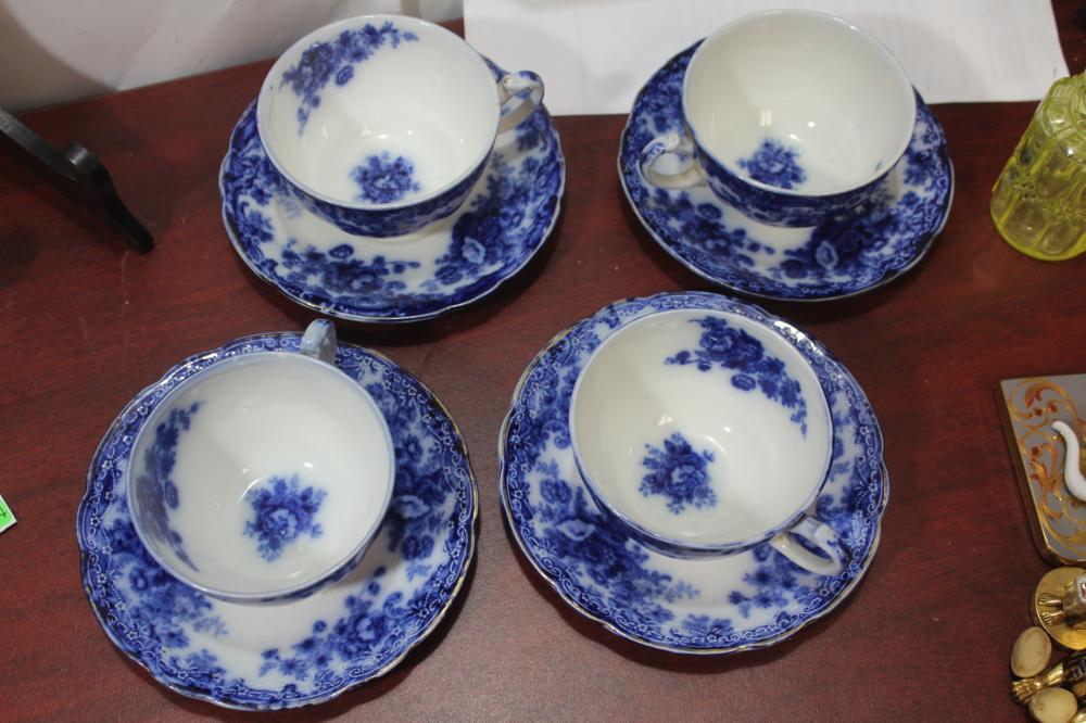 A Burslem Flow Blue Cup and Saucer