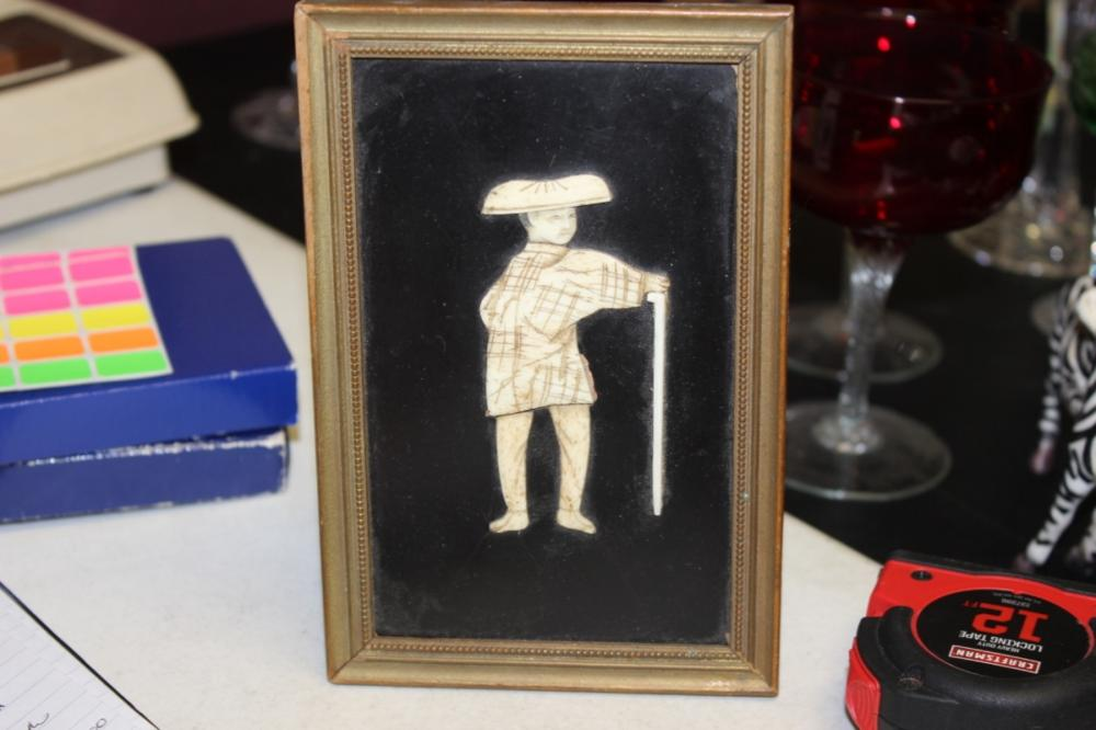 A Bone Carved Figure on Frame
