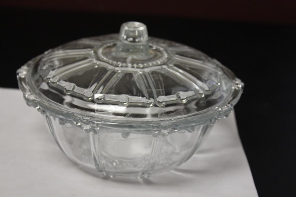 A Round Glass Candy Dish With Lid