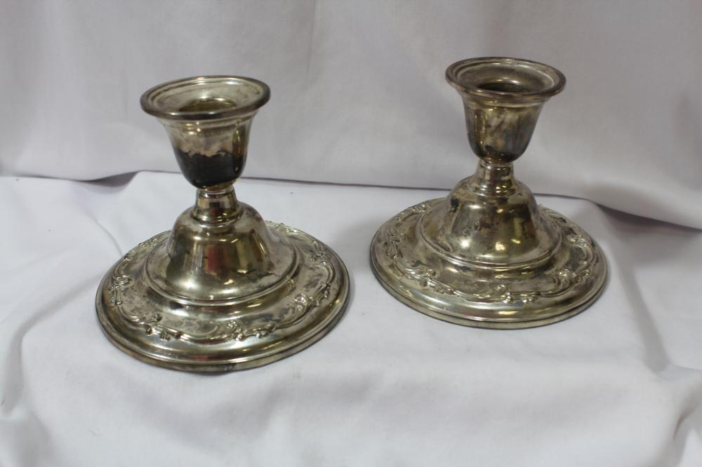 A Pair of Ornate Inernational Sterling Candle Sticks