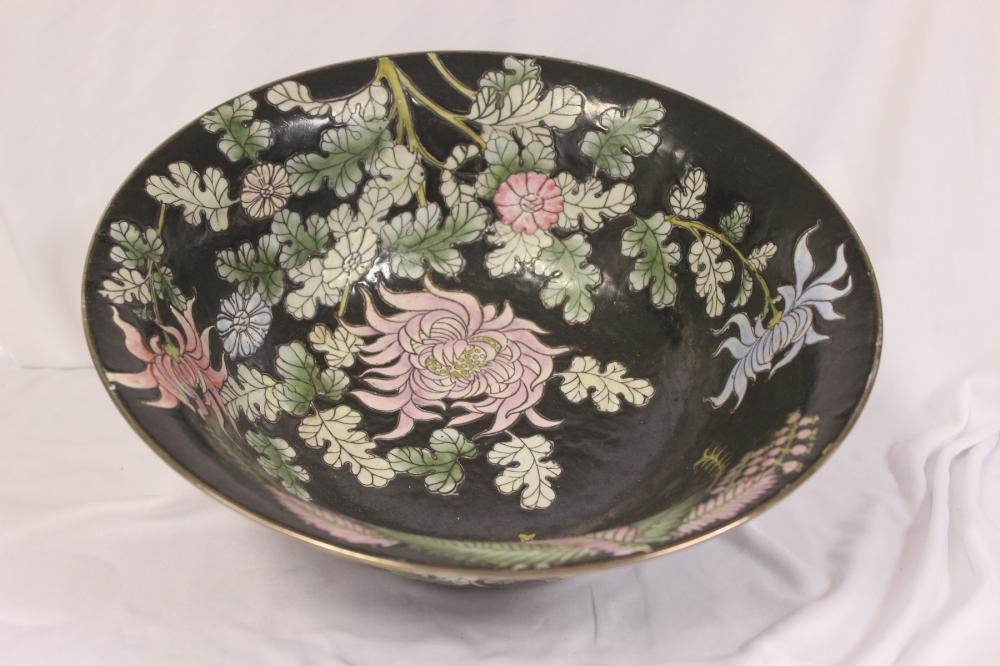 A Chinese Famille Noir Large Center Bowl