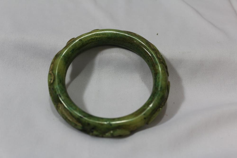 A Carved Jade Bangle Bracelet
