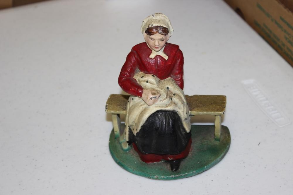 A Vintage Cast Iron Figurine