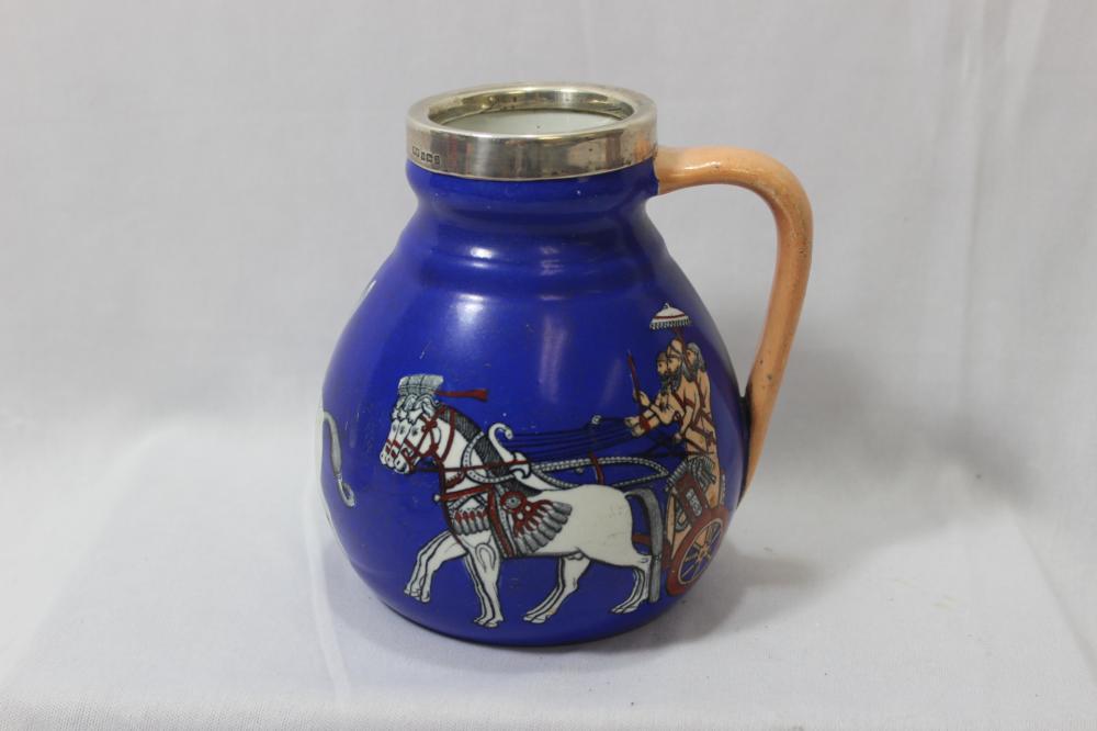 An Antique/Vintage Sterling Rim Mug or Jug