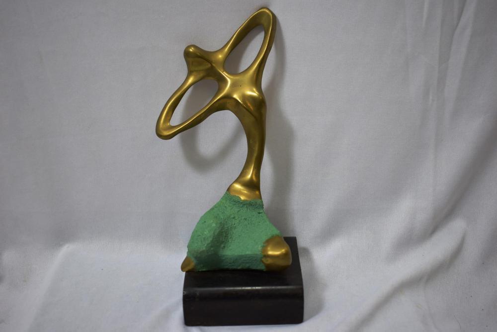 A Modern Brass Statue on Wood Block