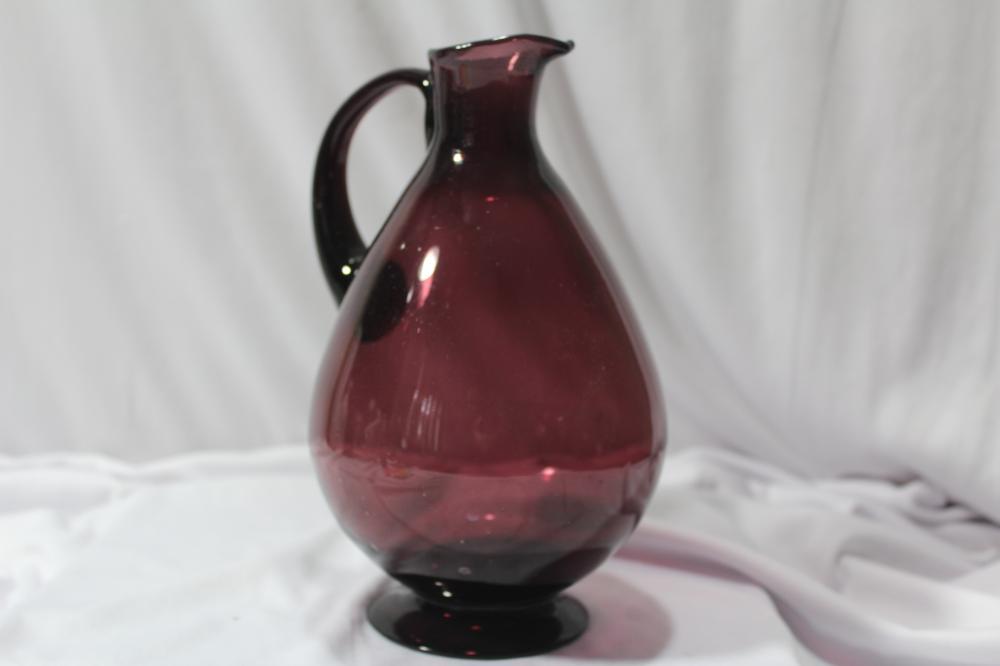 A Handblown Amethyst Glass Pitcher