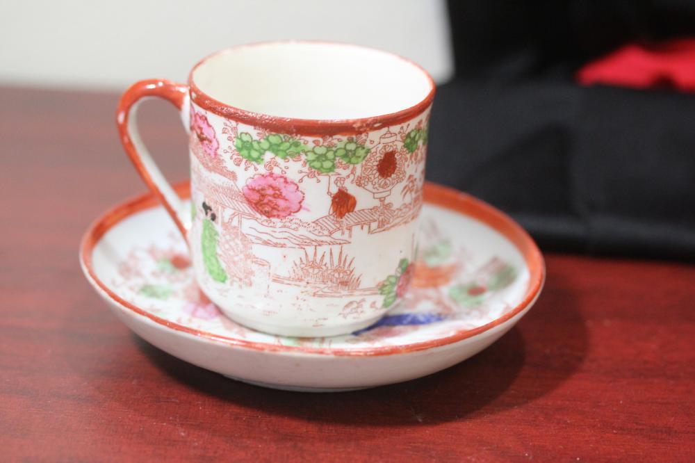 A Japanese Geisha Girl Cup and Saucer