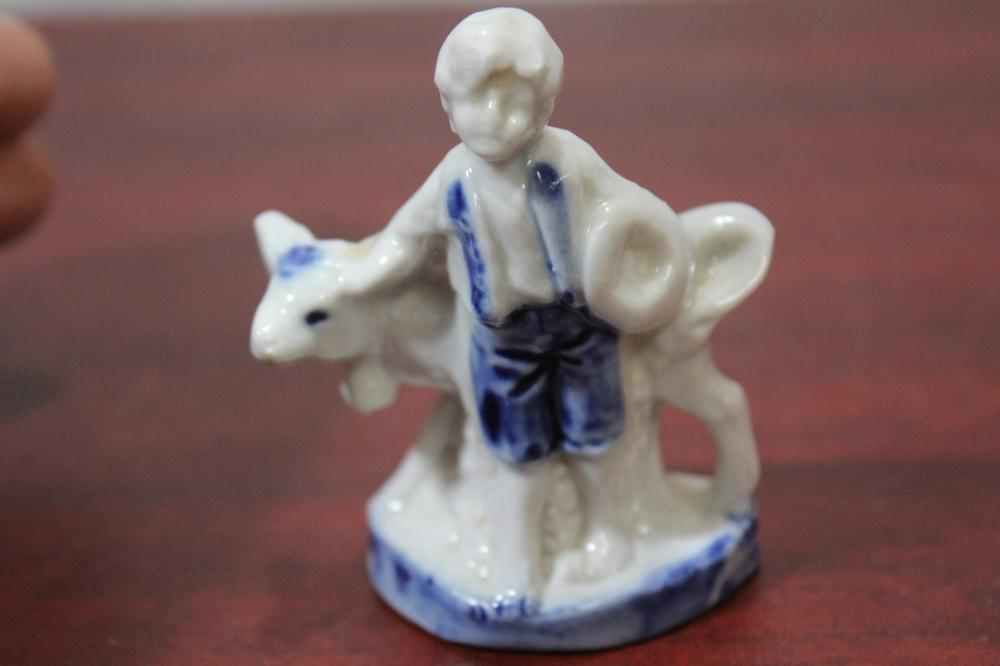 A Small Flow Blue and White German Figurine