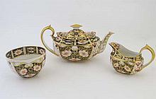 Royal Crown Derby items comprising a tea pot, milk
