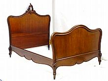 A Louise XV style mahogany Bed with an ornate floral head board and moulded edges standing on decoratively carved feet. 82 ½'' long x 59'' wide x 61 ½'' high
