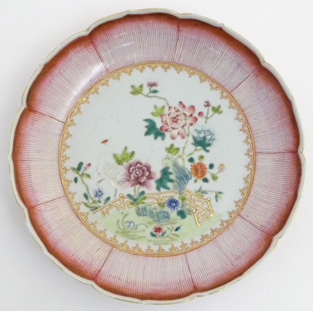 An 18thC Chinese blue and white plate decorated with Daoist emblems, and banded patterned borders. A