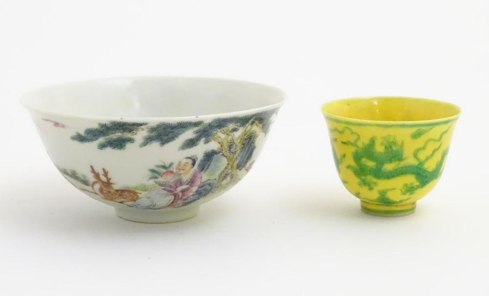 A Chinese famille rose bowl depicting figures and a deer in a landscape. Character marks to base. Ap