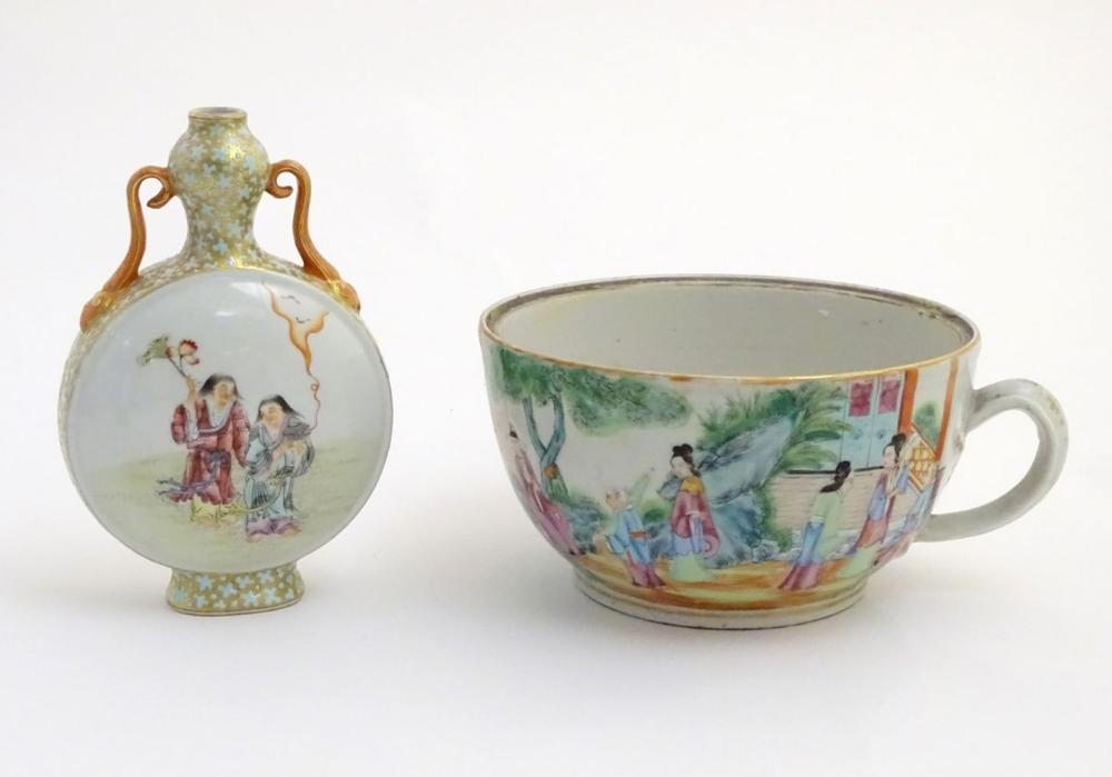 A Chinese twin handled moon vase decorated on one side with a lady and a frog, and two figures on th