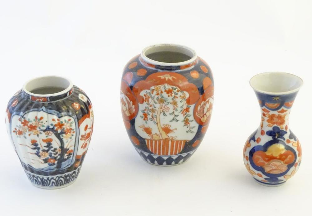 Three Imari vases decorated with panelled floral designs. Largest approx. 5'' high (3)