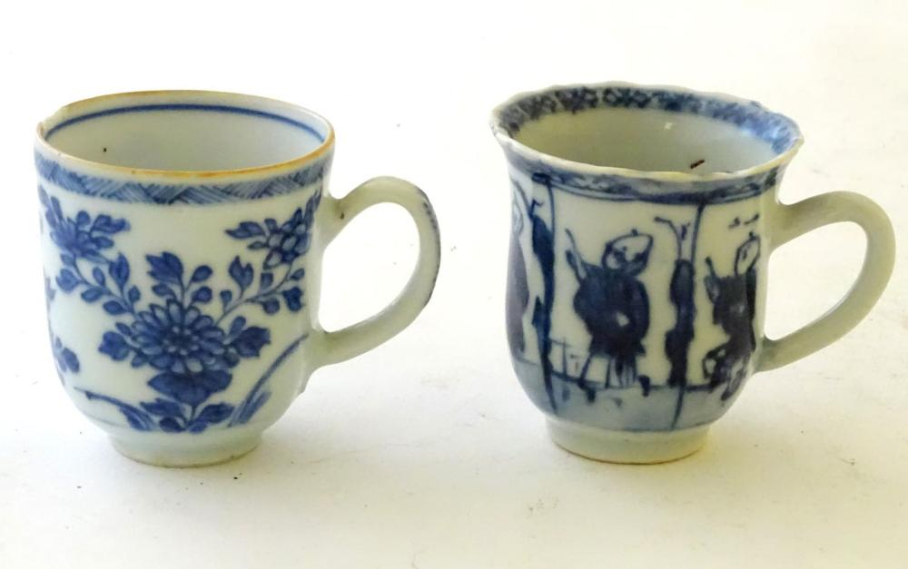 Two Chinese blue and white teacups, one decorated with flowers and foliage, the other with figures.