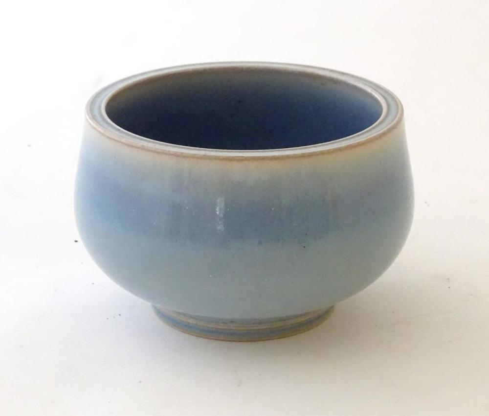 An unmarked high fired blue glazed bowl. Approx. 3'' high.