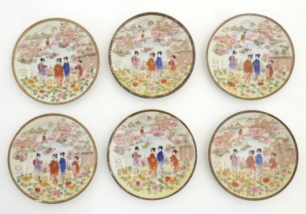 Six Japanese plates depicting figures in traditional dress in an Oriental landscape depicting Mount