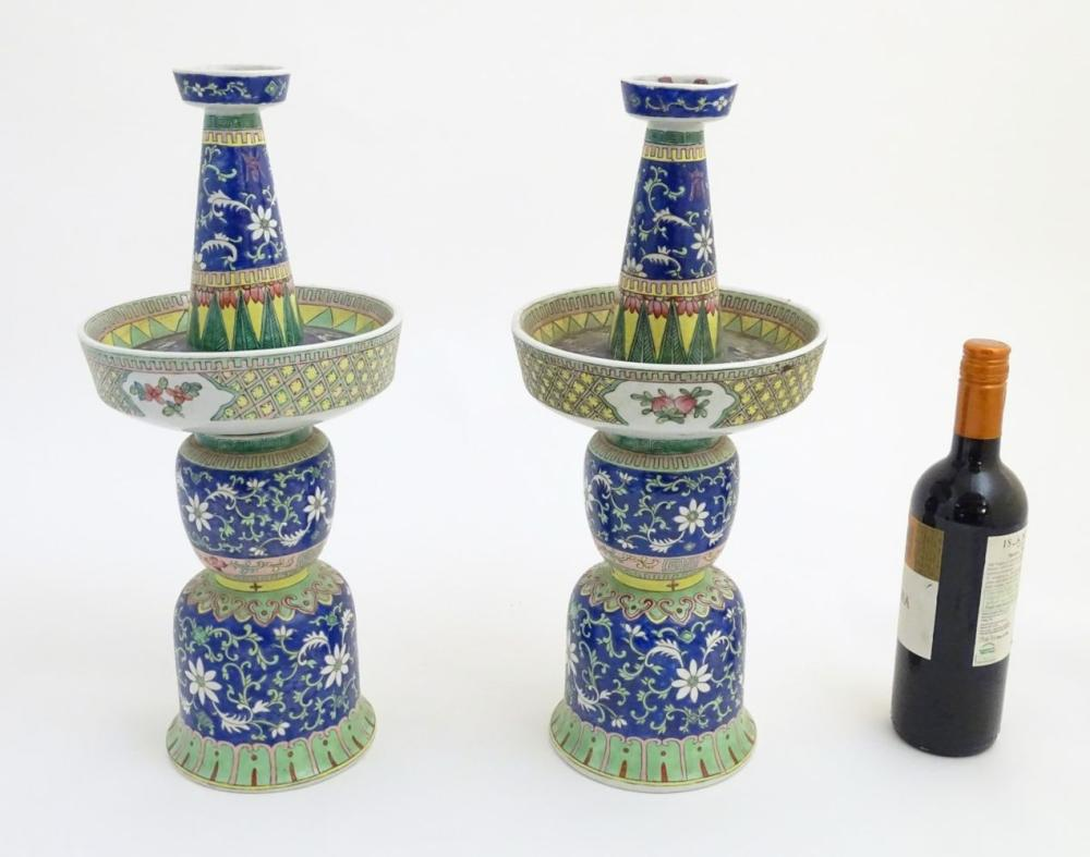 A pair of two-sectional Chinese vases decorated with floral and foliate scrolls. Approx. 17 ¾'' high
