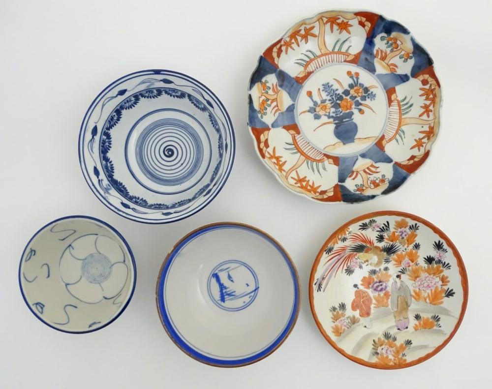 A quantity of Japanese items to include two hand painted plates, one with a scalloped edge and panel