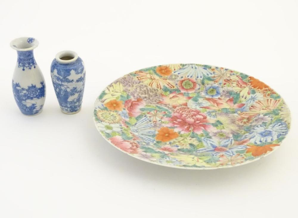 An Oriental plate decorated with stylised flowers, with a scrolling floral design to reverse. Charac