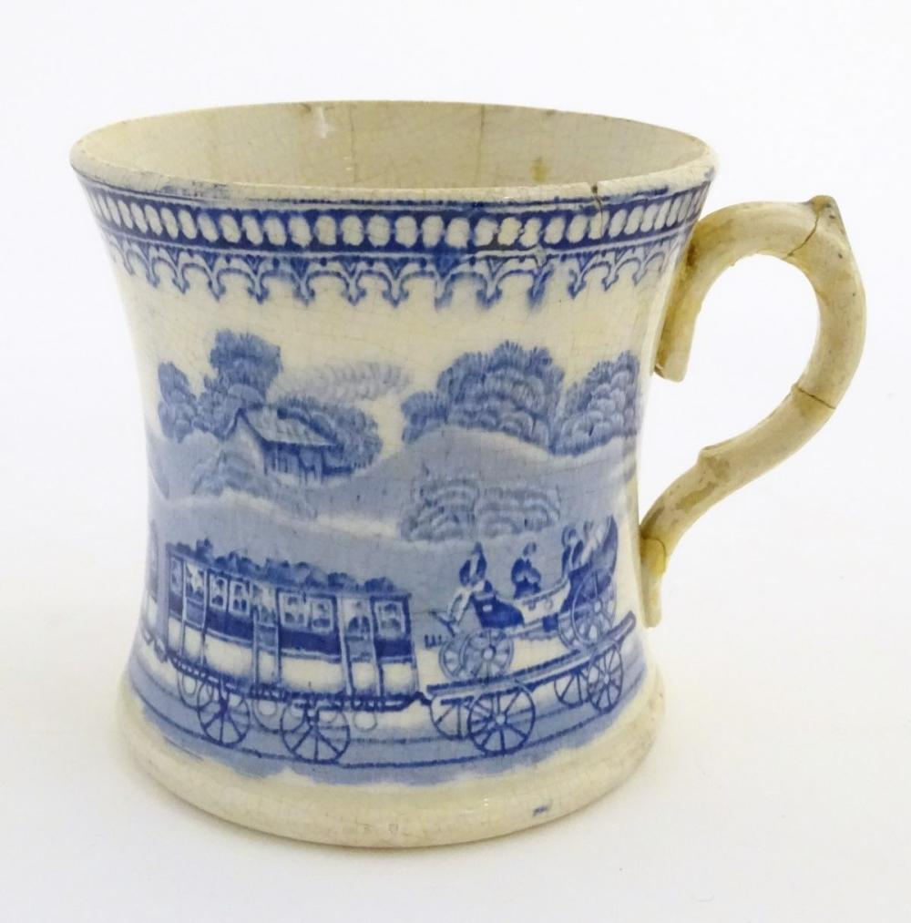A 19thC blue and white tankard decorated with a train 'JACO' in a landscape. Approx. 4 ½'' high.