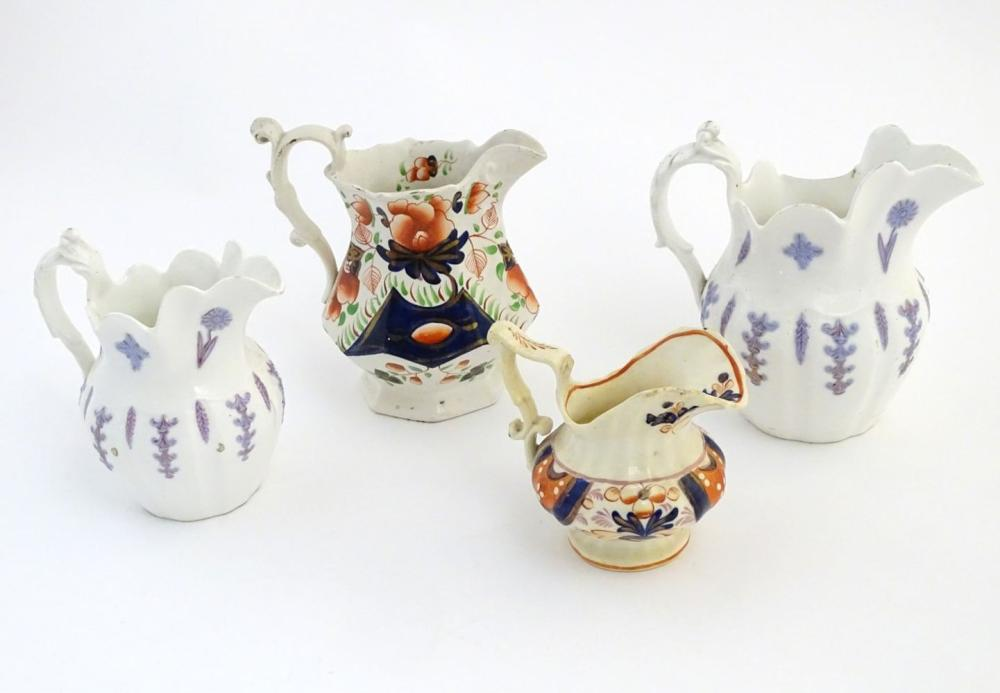 Four assorted Victorian jugs, two with floral / lavender decoration in relief, one in the Gaudy Wels