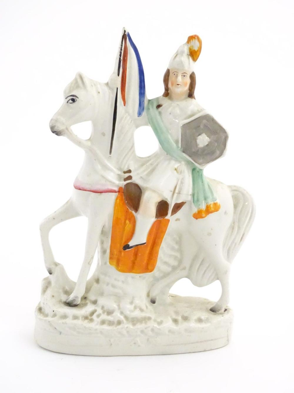 A Staffordshire pottery flat back figure of a knight on horseback. Approx. 11'' high.