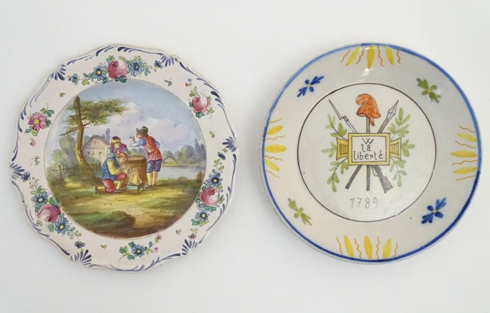 Two French faience plates. One commemorating the French Revolution, decorated with a crossed bayonet