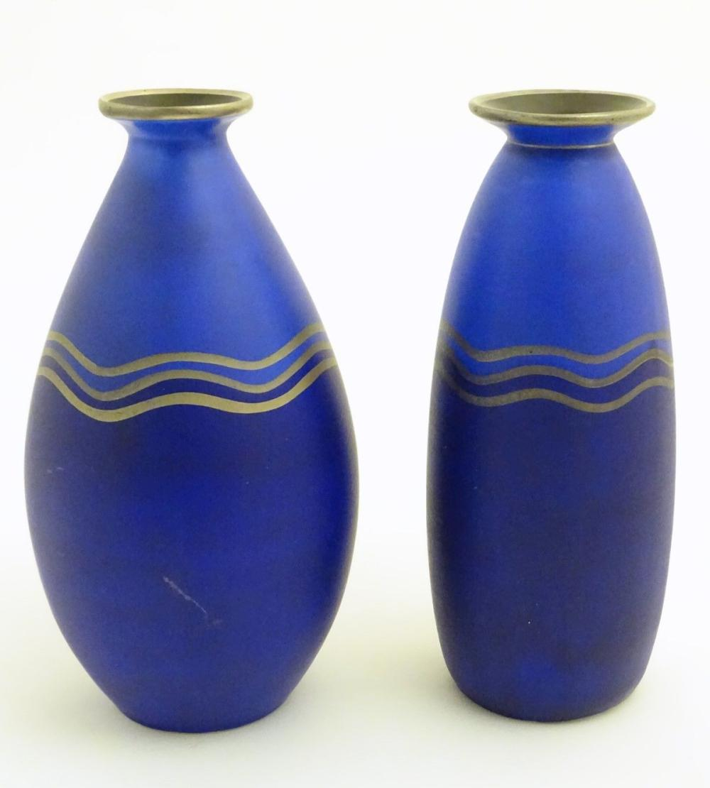 Two blue studio pottery two-tone vases decorated with three gilt undulating bands, gilt rims and a b