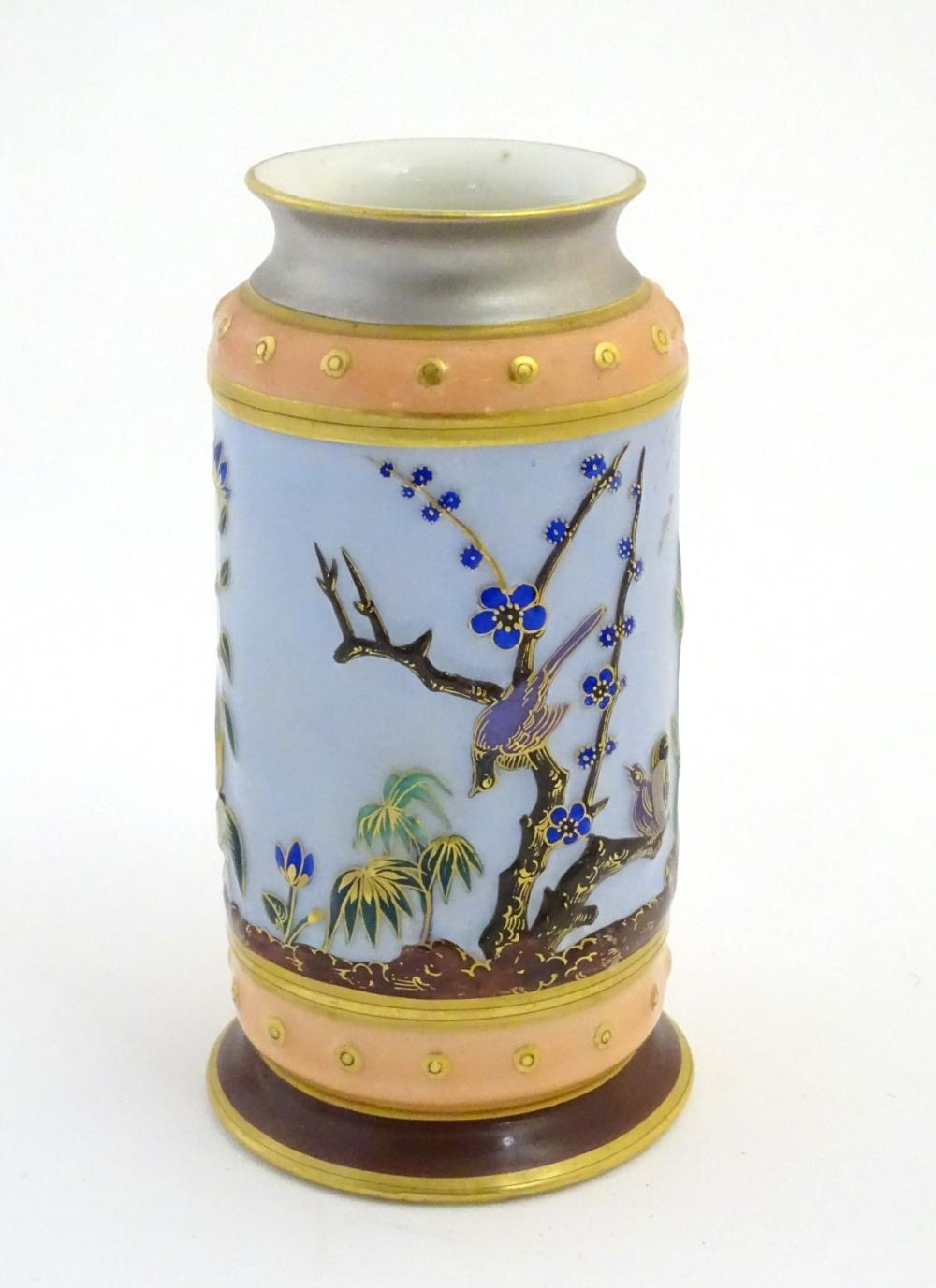 A continental vase decorated with birds and stylised flowers and plants. Marked D&T 2783 under. Appr