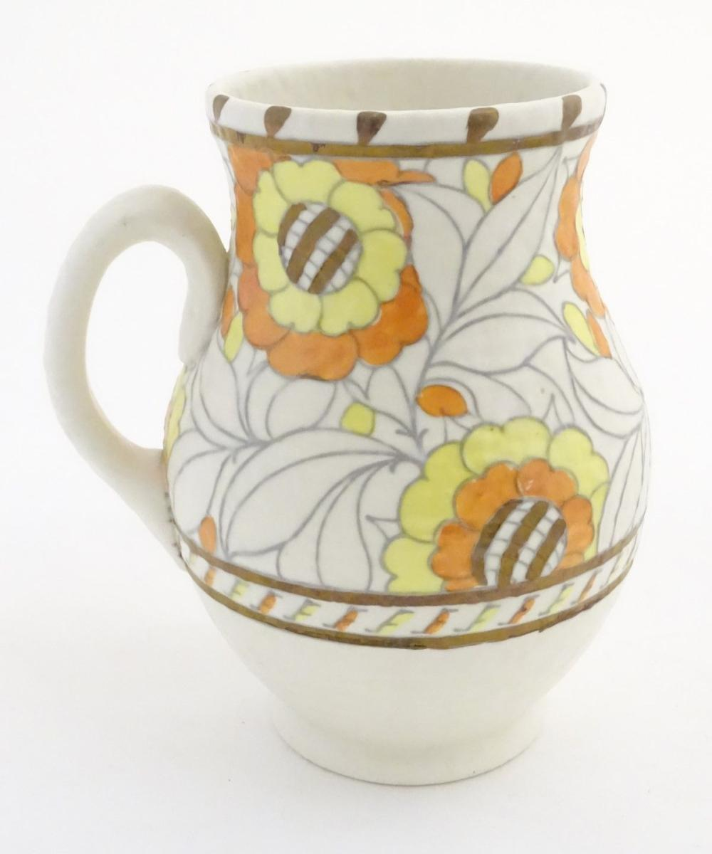 A Crown Ducal single handled vase/jug, model 146, designed by Charlotte Rhead, decorated in the 'Tud