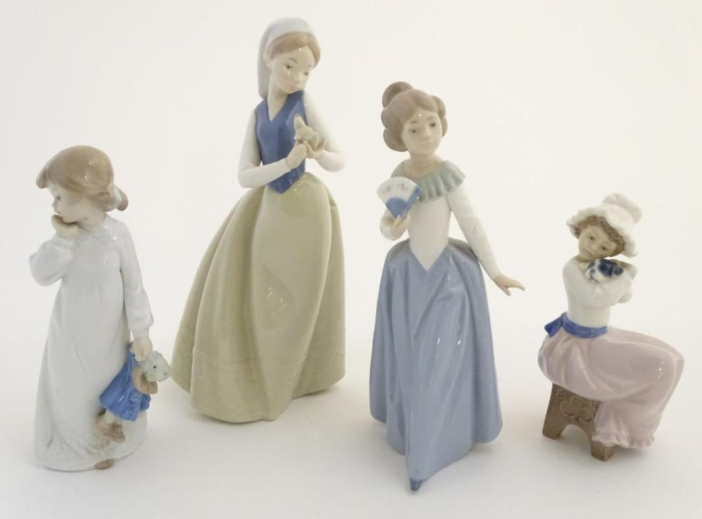 Four Nao (by Lladro) figures, comprising 'My Rag Doll' no. 1108, a young girl holding her rag doll,