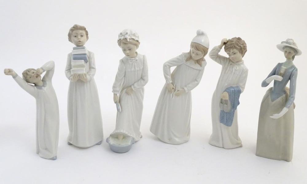Four Nao figures to include 'Boy with Slippers', model no. 232, 'Boy with Books', model no. 233, 'Gi