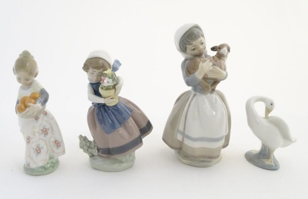 Three Lladro figures, comprising 'Spring is Here' no. 5223, a girl holding a flower pot, 'Valencia G