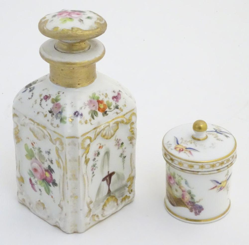 Two Continental lidded ceramic containers; a small pot decorated with hand painted birds, fruit and