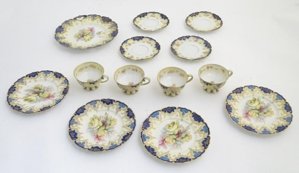 An Edwardian tea set comprising, 4 tea cups and saucers, 4 side plates and a serving plate, with flo
