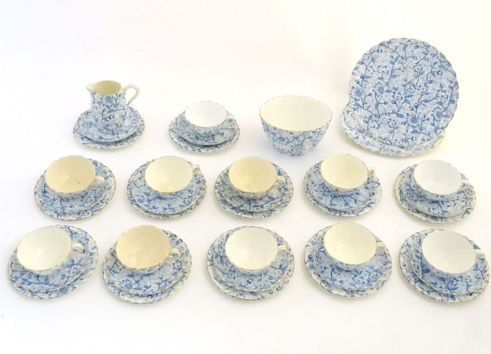 A quantity of late 19th/early 20thC teawares with a blue and white flower transfer decoration, with