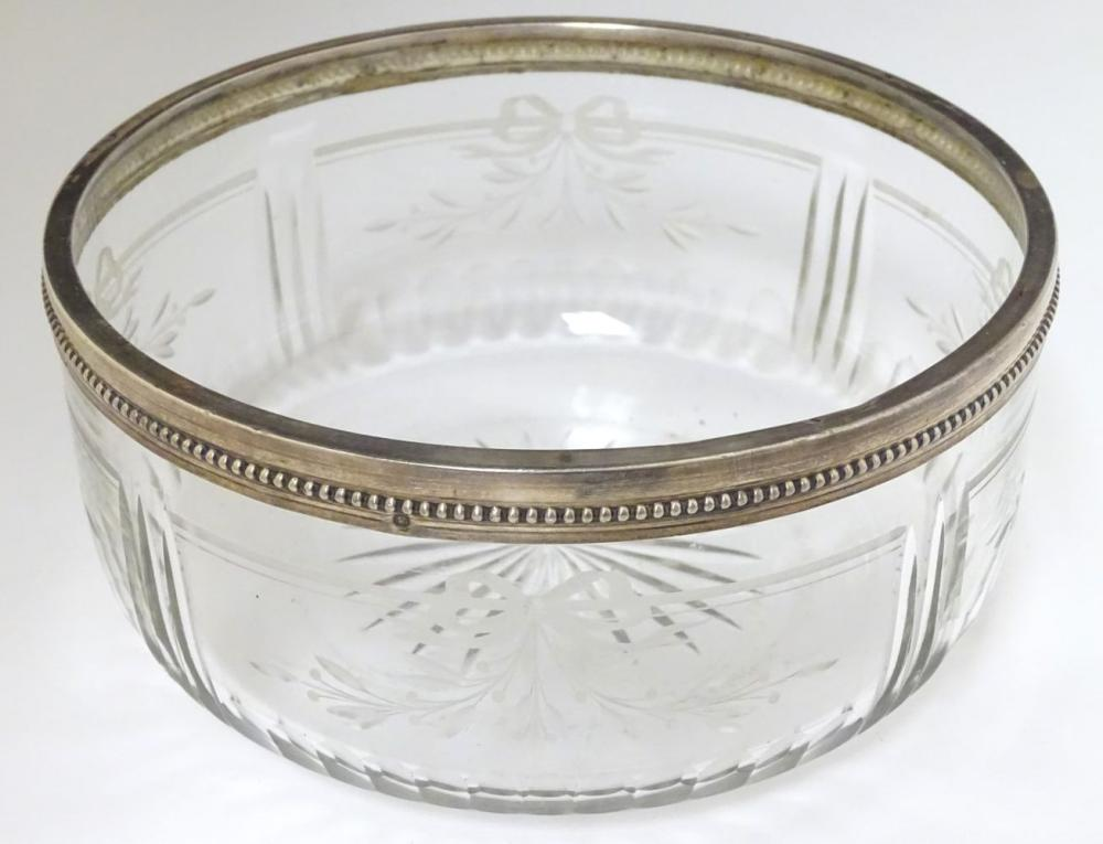 A circa 1900 silver plate rimmed glass bowl , with star cut base and wheel cut ribbon and foliate de