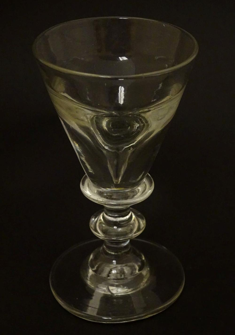 Glass: a late Georgian Toastmasters / Illusion wine glass of pedestal form, standing 4'' high